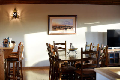 Dining Table Near Kitchen at River View Lodge