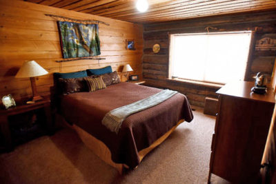 Main Floor Bedroom With Queen Bed Chisum Lodge 2