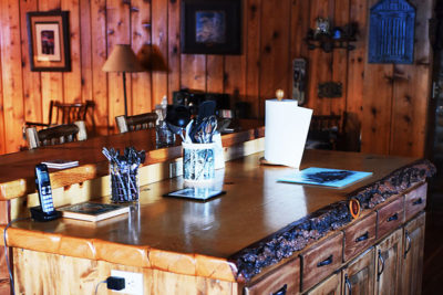 Custom Log Cabin Kitchen in Vacation Rental the Chisum Lodge