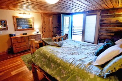 Master Bedroom with Doors to Deck at the Chisum Lodge