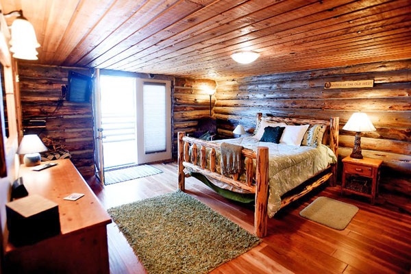 Master Bedroom with Private Deck Entry at the Chisum Lodge in Whitefish Montana