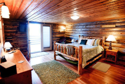 Master Bedroom in Log Cabin at the Chisum Lodge