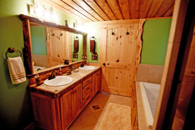 Master Bath with Jacuzzi and Custom Woodworking Chisum Lodge