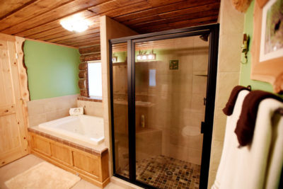 Master Bath with large tiled shower at the Chisum Lodge