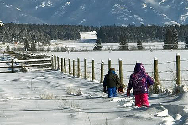 Kids walking in the snow